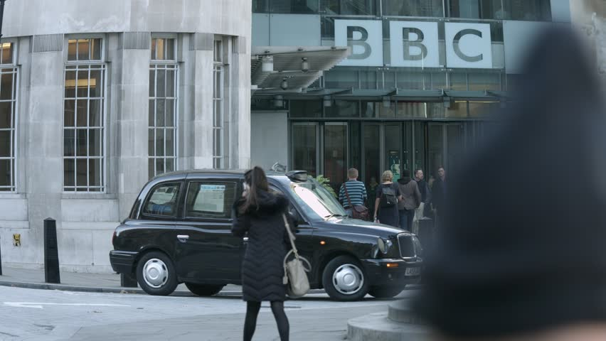 PORTLAND PLACE, REGENT STREET, LONDON - NOVEMBER 2, 2016. The entrance of BBC Broadcasting House in Portland Place, Regent Street, London. Black cab pulls out of the forecourt.