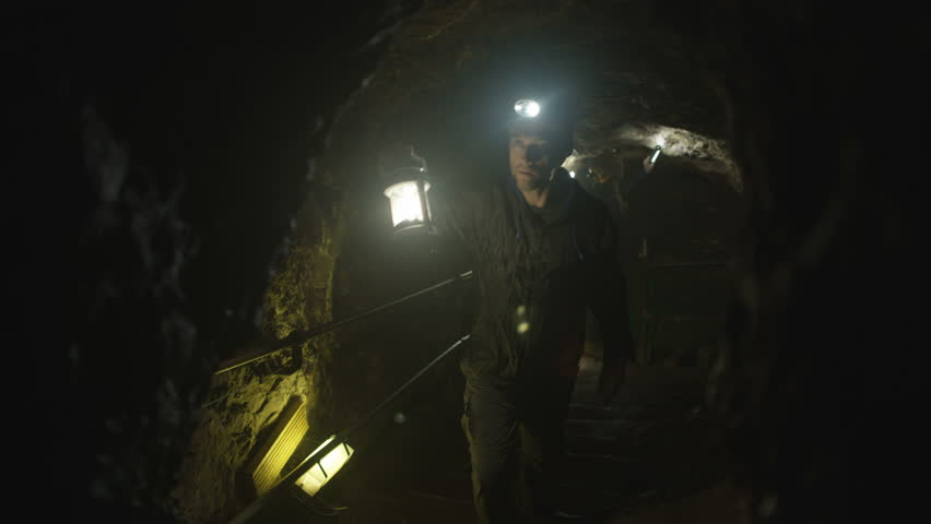 4K Team of potholers with hard hats and lamps exploring underground cave system (UK-Oct 2016) | Shutterstock HD Video #21886063