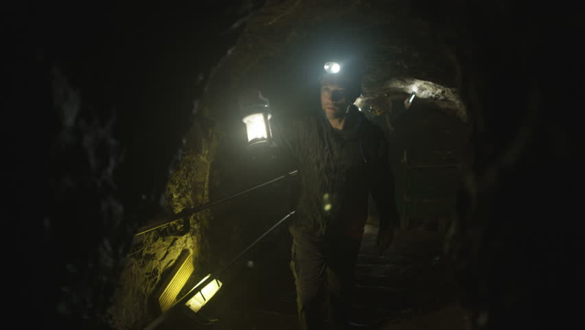 4K Team of potholers with hard hats and lamps exploring underground cave system (UK-Oct 2016) | Shutterstock HD Video #21886105