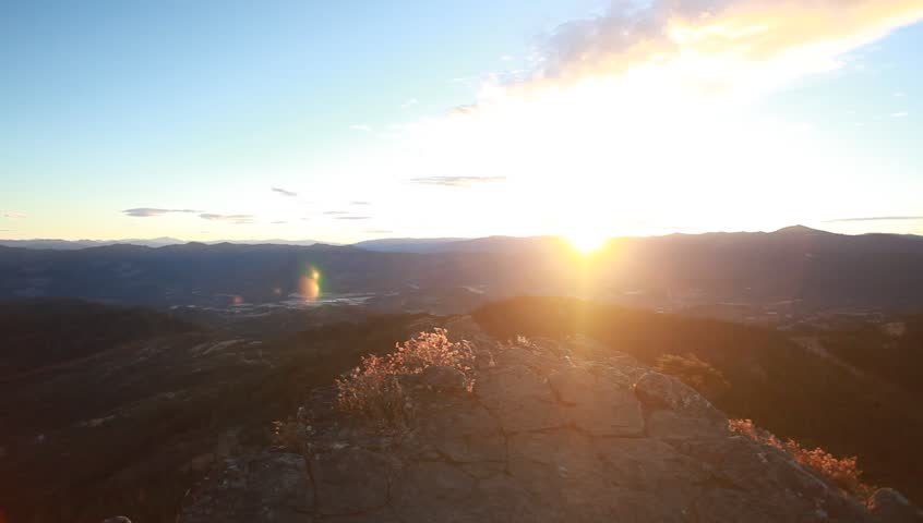 A man standing by the sunset  on a mountain | Shutterstock HD Video #21891937