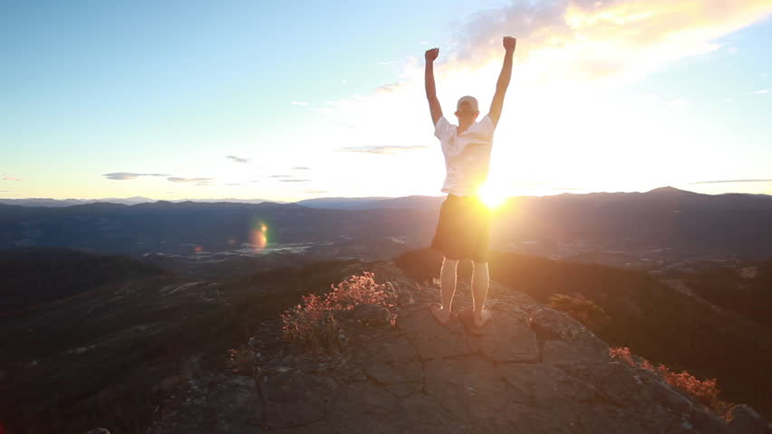 Cinemegraph of a man on a mountain at sunset | Shutterstock HD Video #21891940