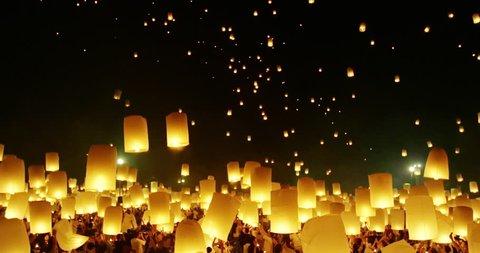 Lanterns floating in night sky at Yi Peng Festival. Chiangmai, Thailand. 4k
