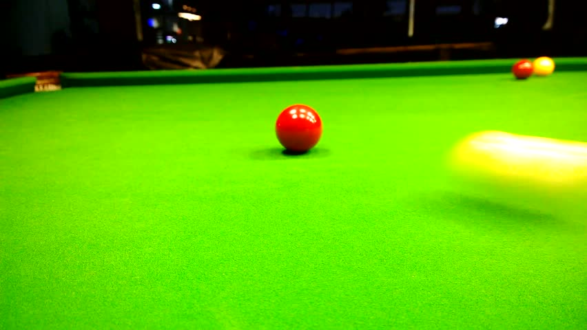 The game of snooker. The cue ball after the collision with the object ball is heading back