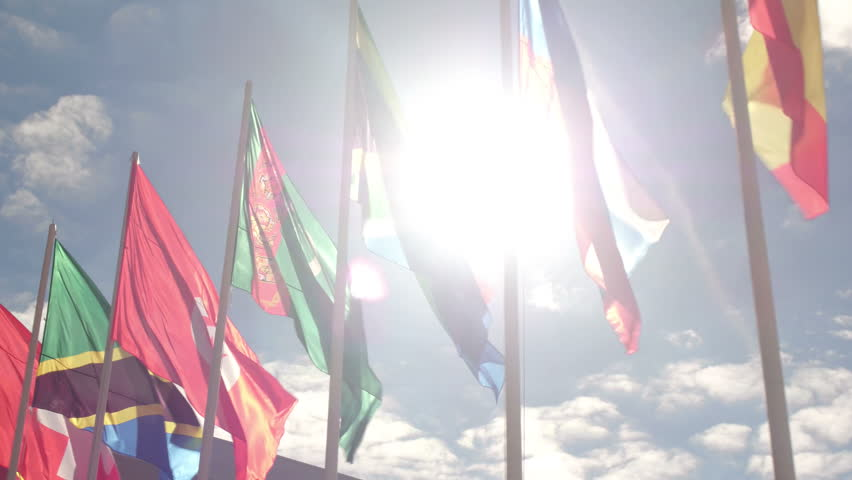 Various world flags flying on flagpoles