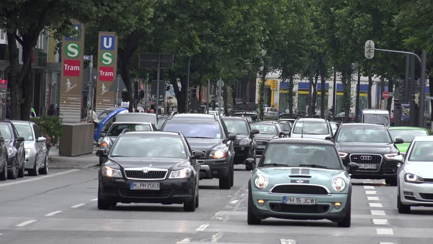 MUNICH - GERMANY, JULY 13, 2014, 4K Heavy traffic street in downtown, car congestion by day