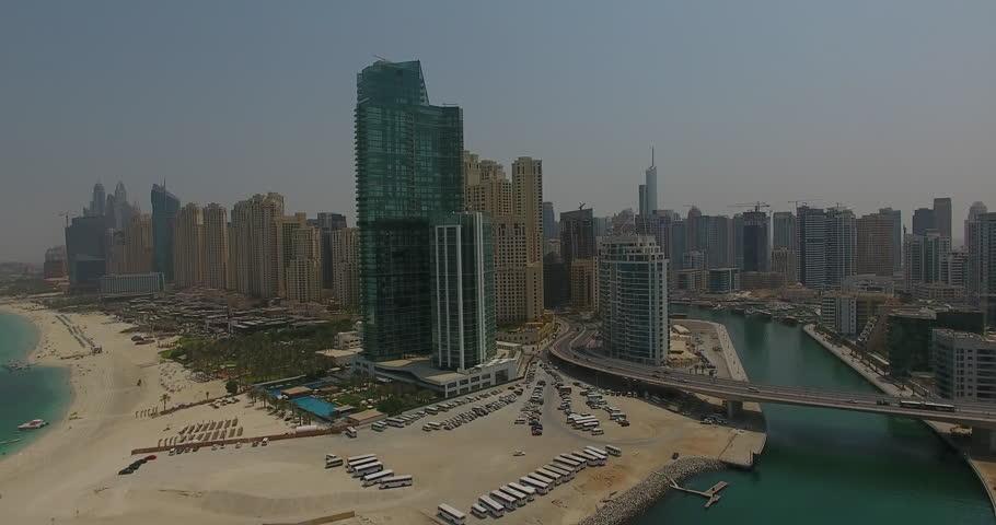 A city view of Dubai with a bridge entering the city