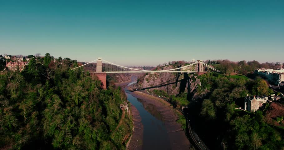 Aerial shot of Isambard Kingdom Brunel's iconic Bristol Clifton Suspension Bridge. Beautiful smooth drone shot of the Avon Gorge and the suspension bridge filmed on a sunny day in December.