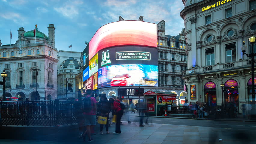 London, England. Circa 2016. Hyperlapse of the crowded Piccadilly Circus in London's West End, City of Westminster. The Circus is known for its video display and neon signs. From day to night.