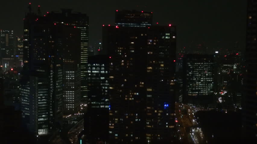 Tall modern skyscraper by night in crowded Tokyo business area, building tower | Shutterstock HD Video #22020331