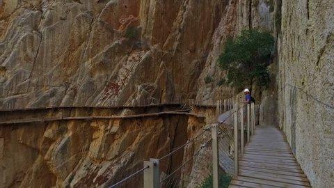 Malaga, Spain. Circa September 2016. Man taking a picture in Royal Trail (El Caminito del Rey) in gorge Chorro, Malaga province, Spain