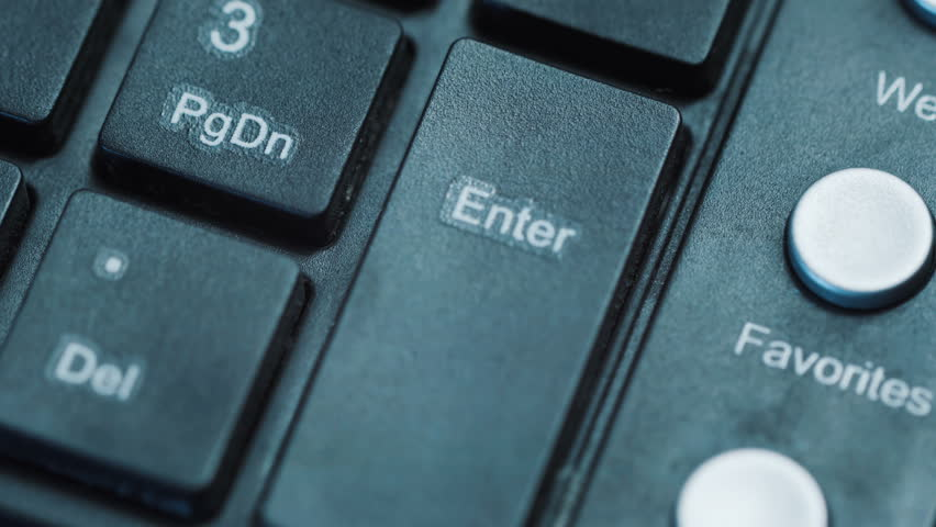 Finger pressing enter button 1, macro. black plastic keyboard. Security systems, entering text, typing text. Internet technologies #22028533
