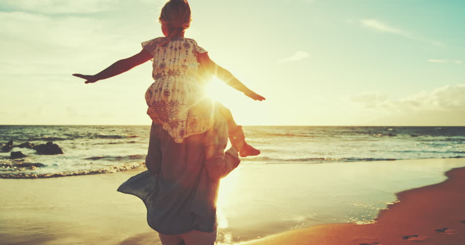 Mother and daughter walking and playing on the beach at sunset | Shutterstock HD Video #22034419