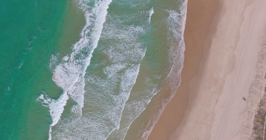 Birds eye view of rolling waves at the beach