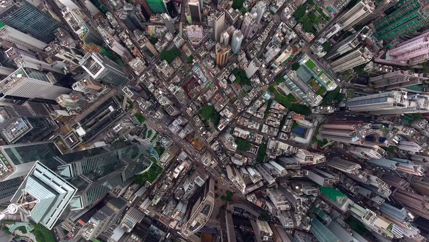 Top view aerial video of development infrastructure city for big population, modern skyscrapers and tall edifices of megapolis, urban transportation system. Video can be used for film or advertising