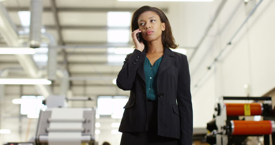 4K Frustrated & annoyed businesswoman in factory dealing with business problems over the phone. Slow motion. | Shutterstock HD Video #22068880