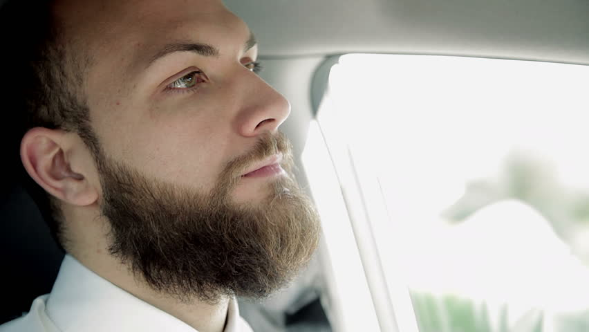 Closeup of serious handsome man driving car feeling sad | Shutterstock HD Video #22092172