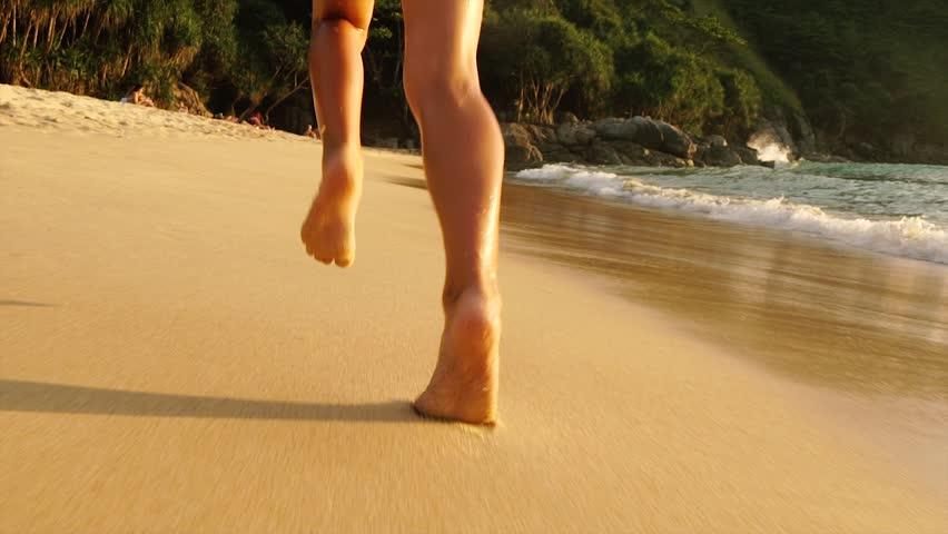 running barefoot on sand