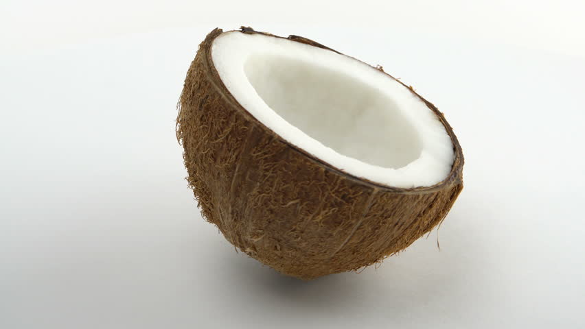 One half of a ripe tropical coconut rotating on a white background. Tropical fruits. Loopable. | Shutterstock HD Video #22126099