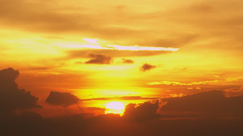 Timelapse of vibrant sunset behind clouds. | Shutterstock HD Video #2215000