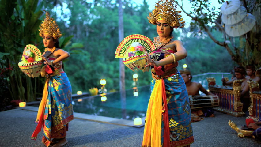 Balinese females performing artistic dance in ceremonial traditional colorful costume using hands and fingers Indonesia South East Asia Royalty-Free Stock Footage #22166686