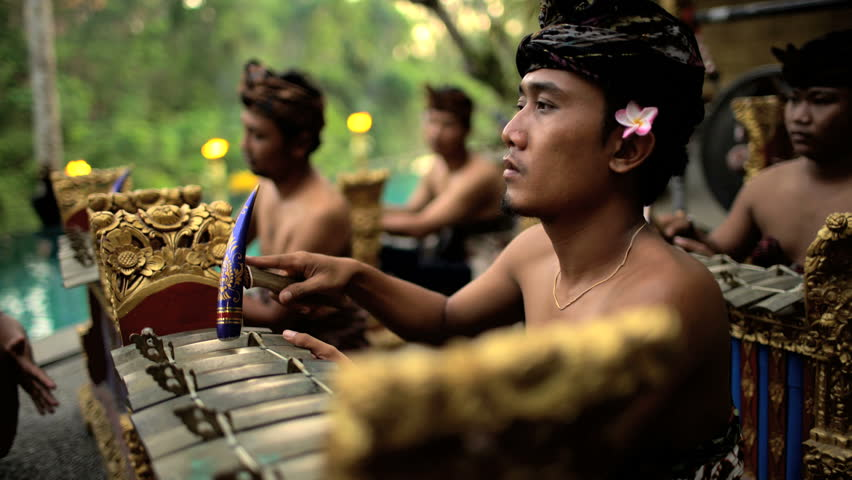 Asian Balinese musician gamelan group playing in traditional dress in a ceremonial celebration performance Indonesia South East Asia | Shutterstock HD Video #22166998