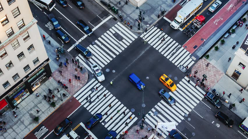 NEW YORK CITY - NOVEMBER 17: (TIMELAPSE) Aerial view from Empire State Building of intersection with pedestrian and vehicle traffic on 34th Street and 5th Ave on November 17, 2016 in New York, USA.