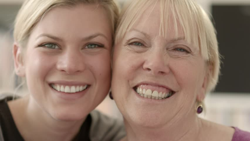 Women portrait with happy mom and daughter smiling, hugging, showing love and affection. Close up | Shutterstock HD Video #2217415