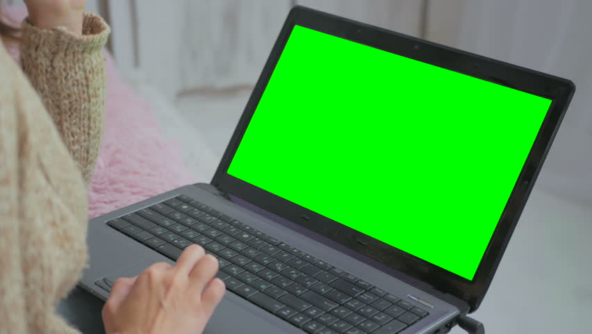 Woman using laptop with green screen. Business, communication, freelance and internet concept | Shutterstock HD Video #22184257