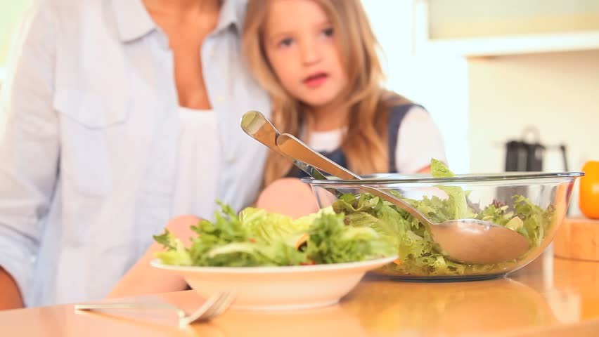 Mother and daughter mixing the salad in the kitchen #2220430