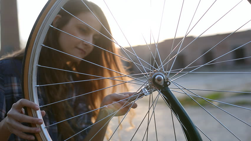 Young woman repair bicycle   Shutterstock HD Video #22212520