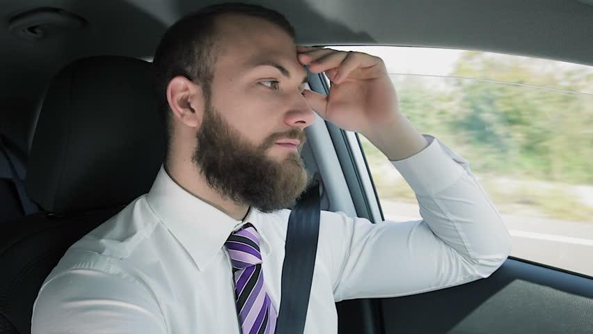 Cool business man in traffic driving | Shutterstock HD Video #22221202