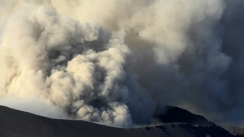 Mt Bromo active volcano summit erupting smoke and ash in barren volcanic National Park environment Java Indonesia South East Asia #22244308