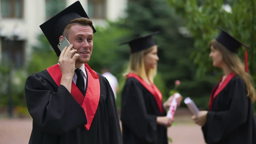 Happy male graduate receiving prestigious job offer, telephone conservation #22260790