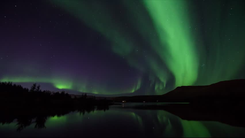 Timelapse video of Icelandic northern lights in autum time with mirror view on the lake