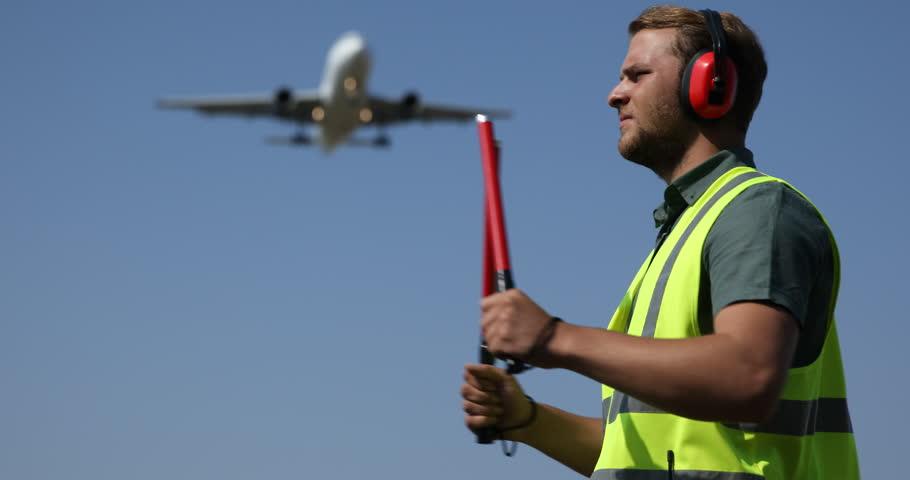 Aircrew Controller Man Show Position Marshal Signaling Aircraft Passing Overhead. Ultra High Definition, UltraHD, Ultra HD, UHD, 4K, 2160P, 4096x2160