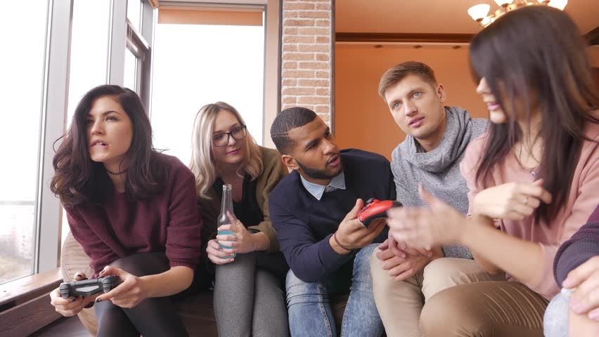 Group of multi ethnic friends having fun playing on game console in home interior #22299277