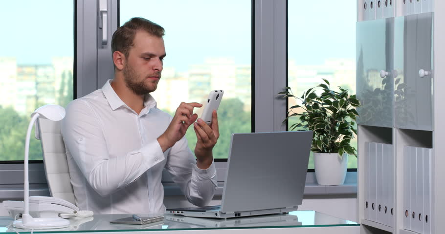 Chief Executive Officer Using a Mobile Phone Happy Social Networking Office Room. Ultra High Definition, UltraHD, Ultra HD, UHD, 4K, 2160P, 4096x2160 | Shutterstock HD Video #22303201