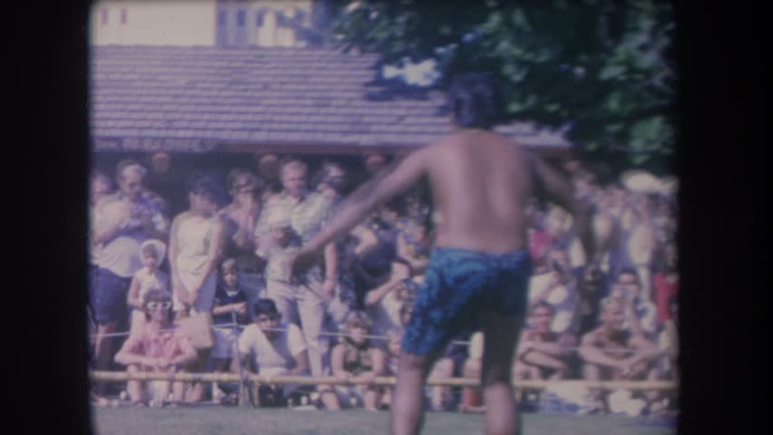 HAWAII 1969: tan gentleman putting on a show in blue shorts