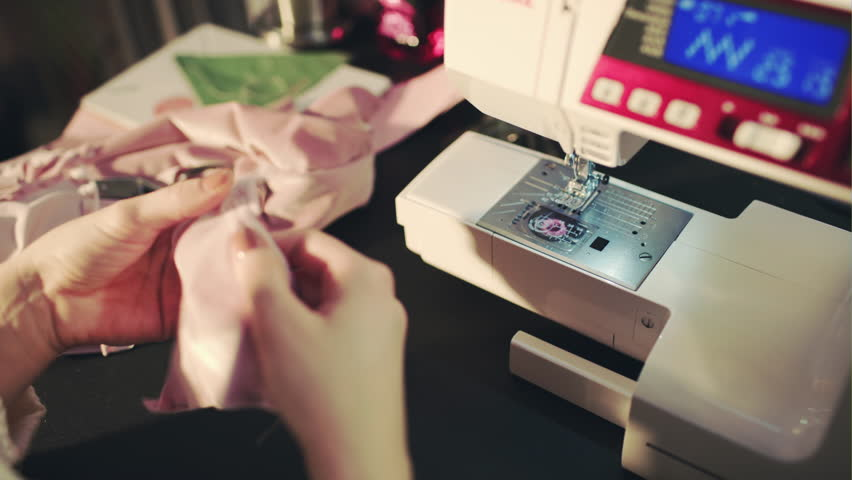 Girl and a sewing machine, creative process in the sewing workshop   Shutterstock HD Video #22326058