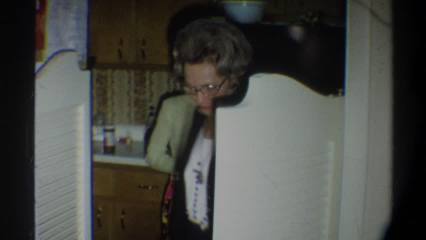 FLORIDA 1974: an older woman walking into the room while smiling to the camera | Shutterstock HD Video #22327771
