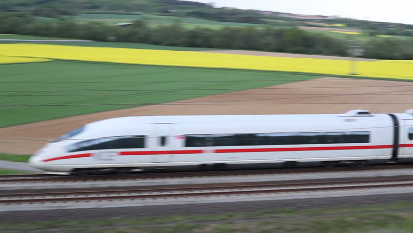WALLAU, GERMANY – MAY 4: A passing german highspeed train (ICE) on the Frankfurt-Cologne line on May 4, 2012 near Wallau, Germany. The maximum speed of these highspeed trains is around 320km/h.