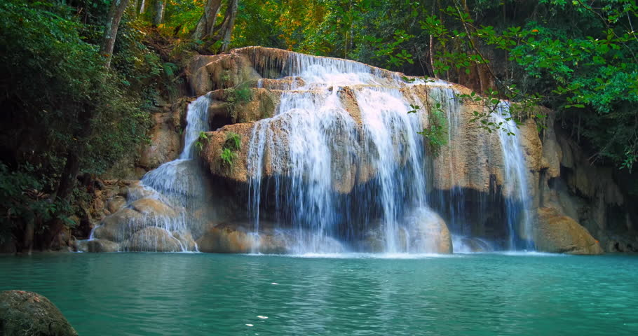 Serene and remote Erawan waterfall in tropical rain forest flows in emerald pond | Shutterstock HD Video #22338703