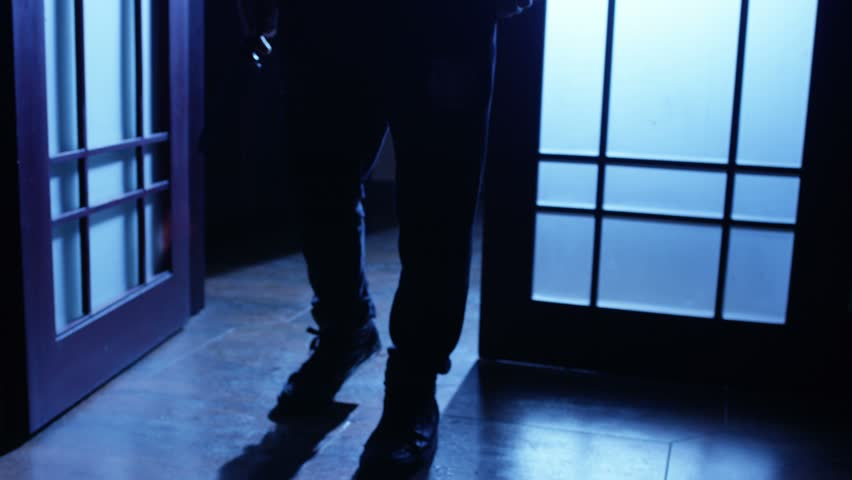 Killer or serial maniac with knife approaching to the door and entering to the room. Shot on RED EPIC DRAGON Cinema Camera. 4K