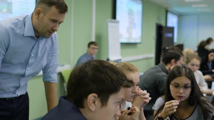 Business coach watching work of the team. | Shutterstock HD Video #22357765