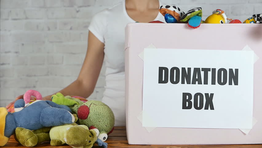 Woman prepare to donate toys in charity shop. Slow motion Royalty-Free Stock Footage #22367656