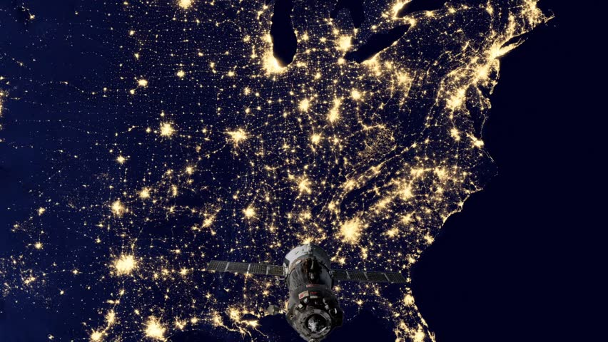 A satellite orbiting over the U.S. power grid Royalty-Free Stock Footage #22381708