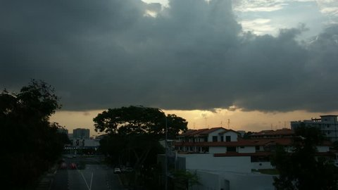 Timelapse of sunset over suburbs, Singapore, Asia.