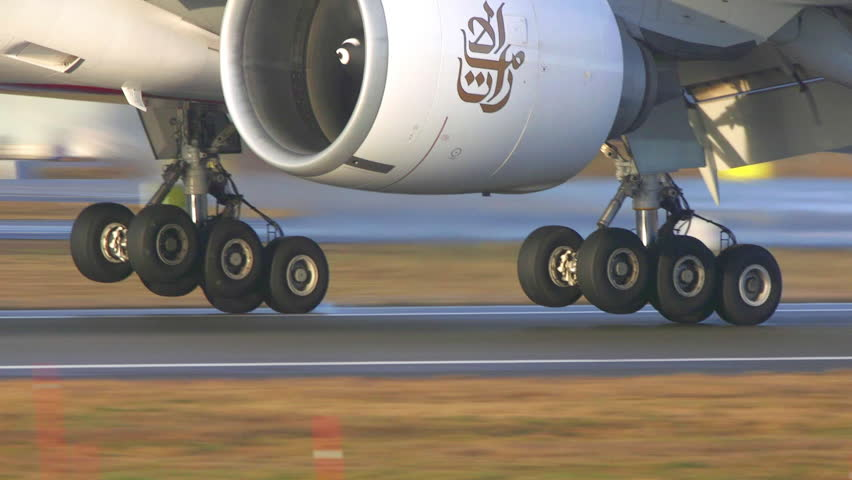 OSLO AIRPORT NORWAY - CA NOVEMBER 2016: huge passenger airplane boeing 777 landing on runway extreme close up view of landing gears touchdown