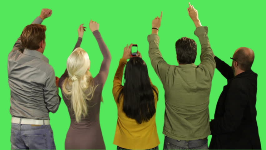 Crowd cheering and taking picture on green screen