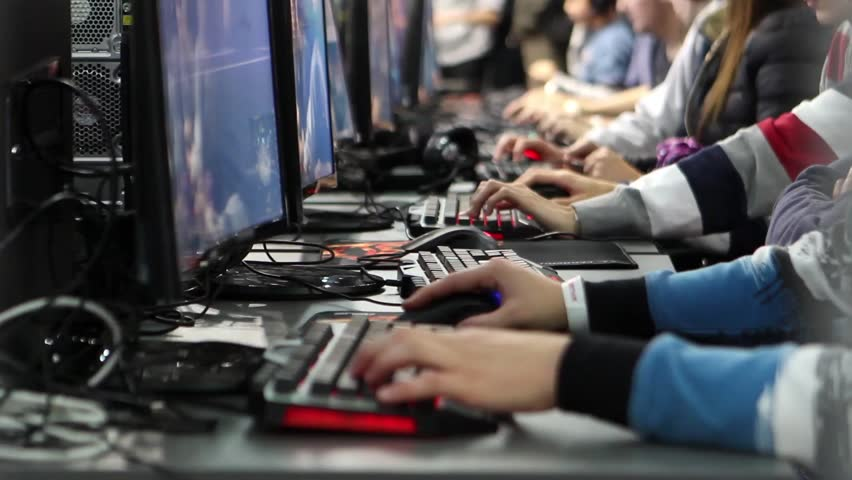 Many people work in Internet cafes, play games and spend time on the Internet: eSports, hobbies, hobby, cybersport,  gaming Royalty-Free Stock Footage #22420981